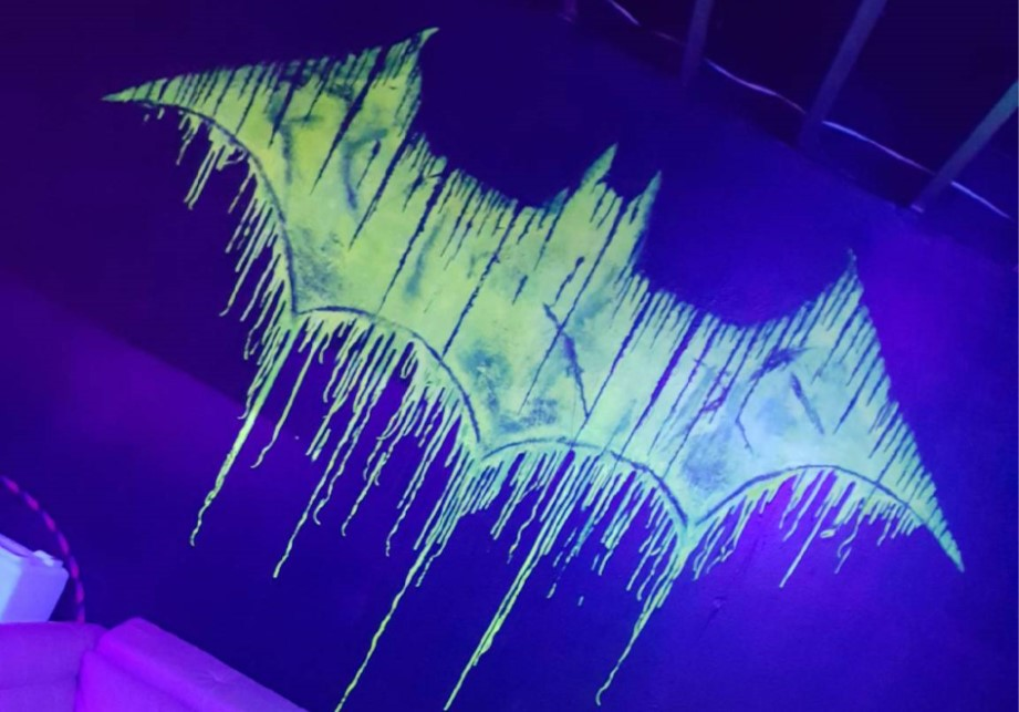Batcave glowing wall art nightclub dance club kansas city downtown Rhythm & Booze
