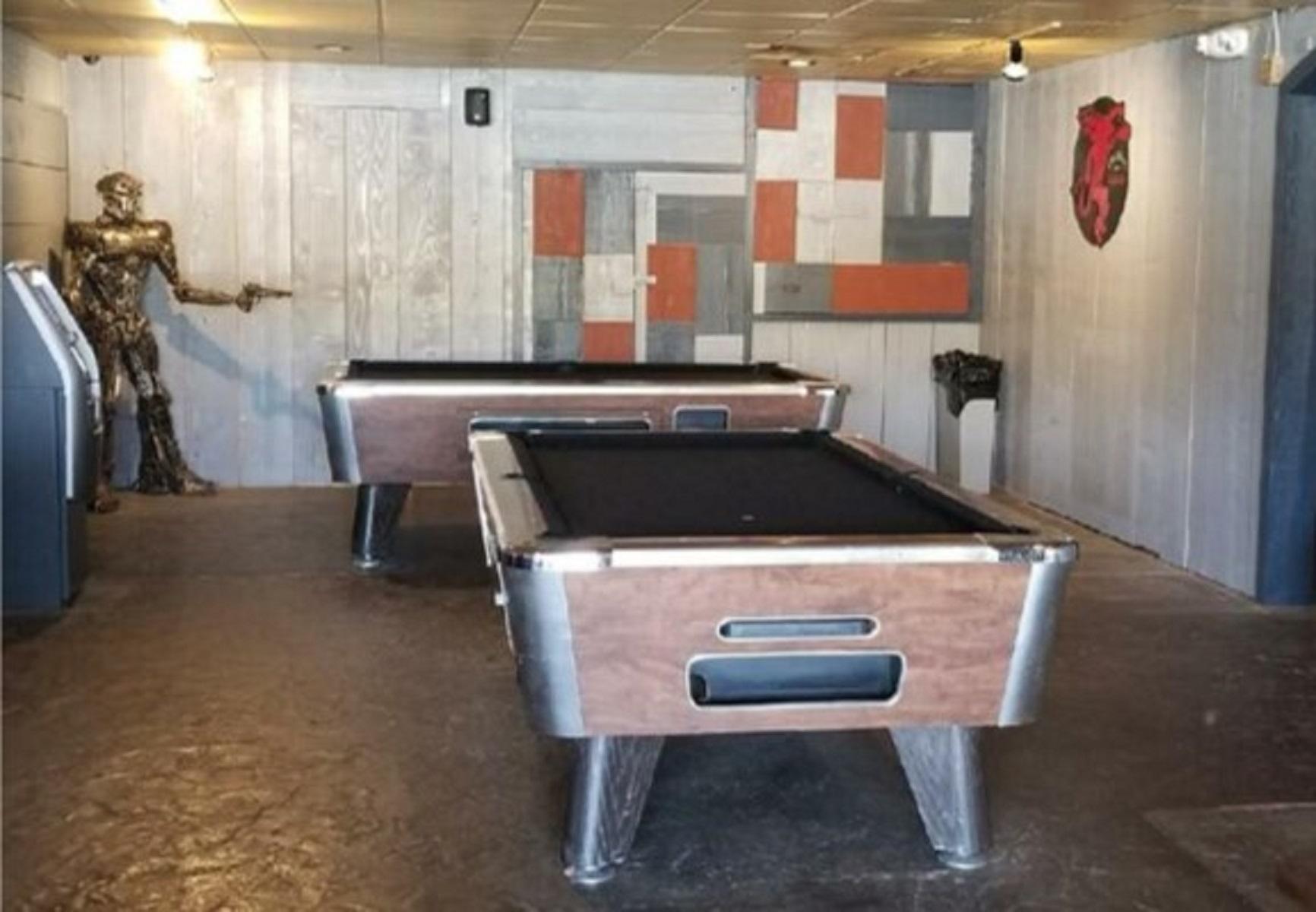 Rhythm and Booze South Pool Room with metal man